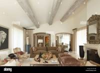 Wide shot of sitting room showing sloping ceiling with ...