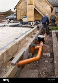 self building house, drainage, man making drain pipe ...