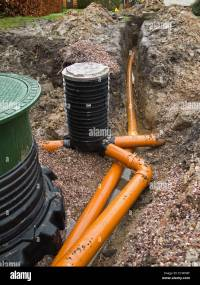 self building house, drainage pipes being connected to