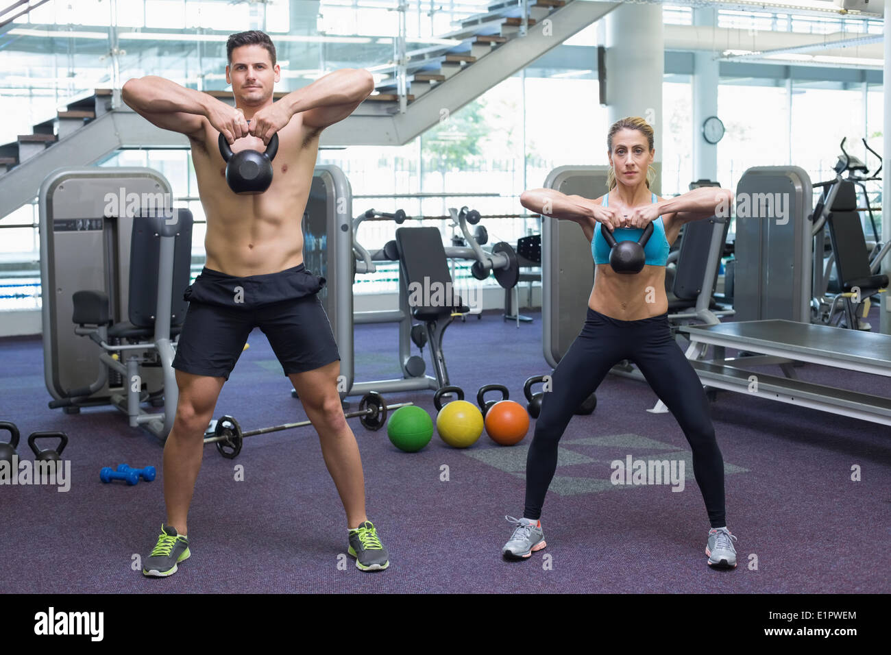 Kettlebell Bodybuilding Bodybuilding Man And Woman Lifting Kettlebells Stock Photo