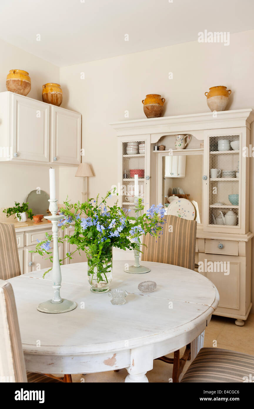 distressed white dining table in provencal style country kitchen with E4CGC6