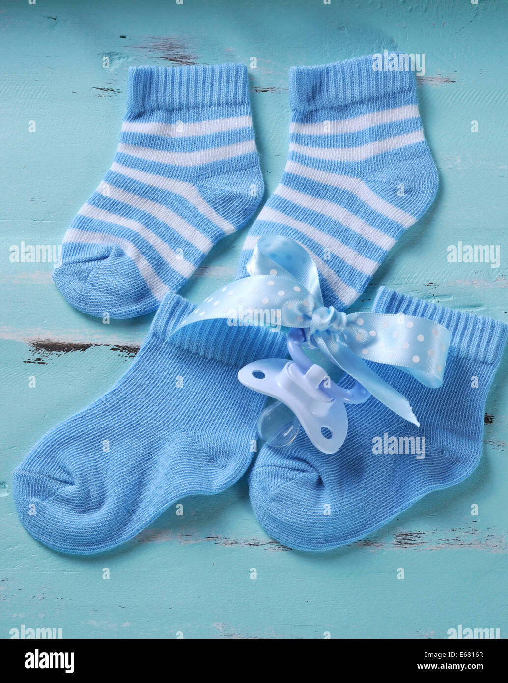 Shabby Chic Vintage Nursery Baby Boy Nursery Blue And White Socks And Dummy Pacifier On Aqua