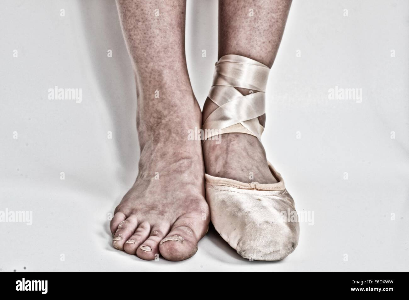 Feet Of A Ballerina One With A Ballet Pointe Shoe And The