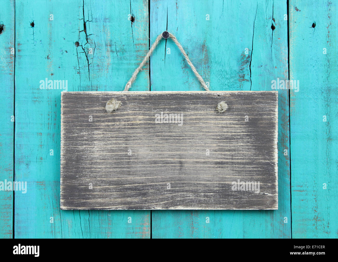 Weathered blank sign hanging on antique teal blue rustic wooden door Stock Photo - Alamy