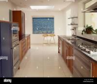Cream Travertine flooring in large modern galley kitchen ...