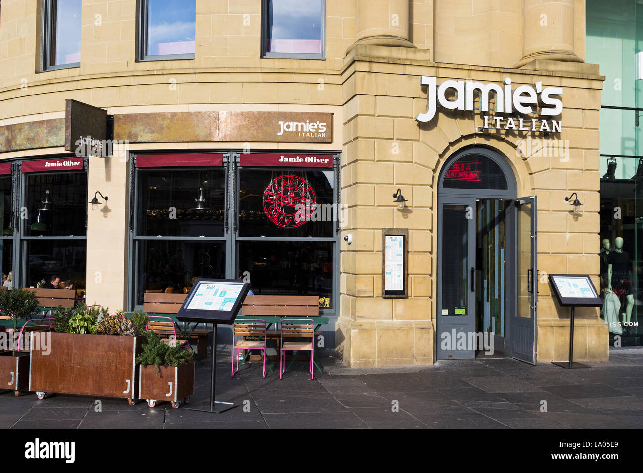 Jamie oliver italian restaurant at newcastle upon tyne showing exterior with diners inside and menu boards