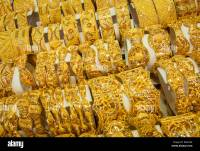 Gold bracelets on display at a jewelry store in the Gold ...