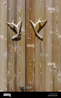 deer antlers as door handles Stock Photo, Royalty Free ...