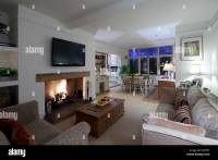 Open plan living and dining room with plasma screen above ...