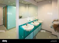 Wash basins, hand dryers and toilet cubicals of modern ...