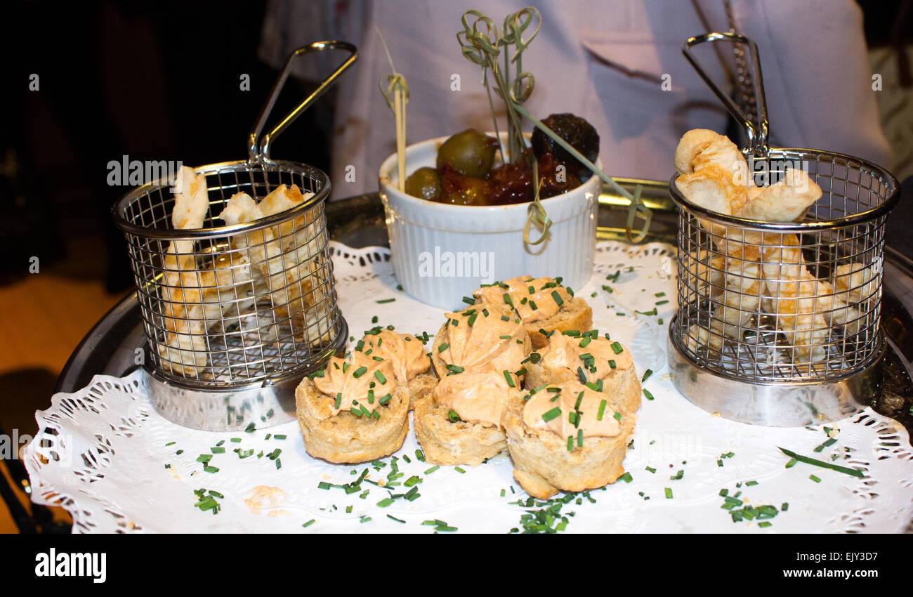 Canapés Show Canapés In A Vip Area Of A Show On A Plate With Chives Olives In