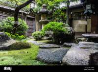 View of a traditional Japanese garden with old lantern in ...