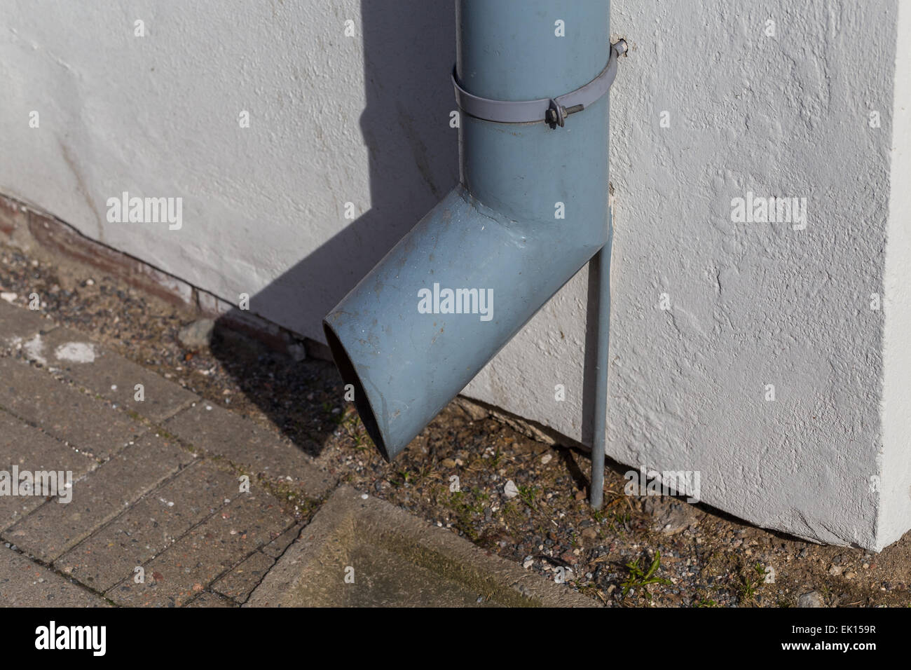 old gutter metal rain drain pipe on the wall Stock Photo