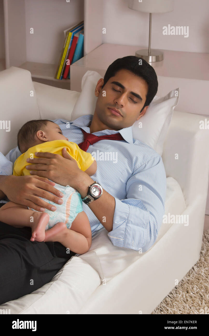 Toddler Half Years Father And Baby Sleeping On Sofa Stock Photo Royalty Free