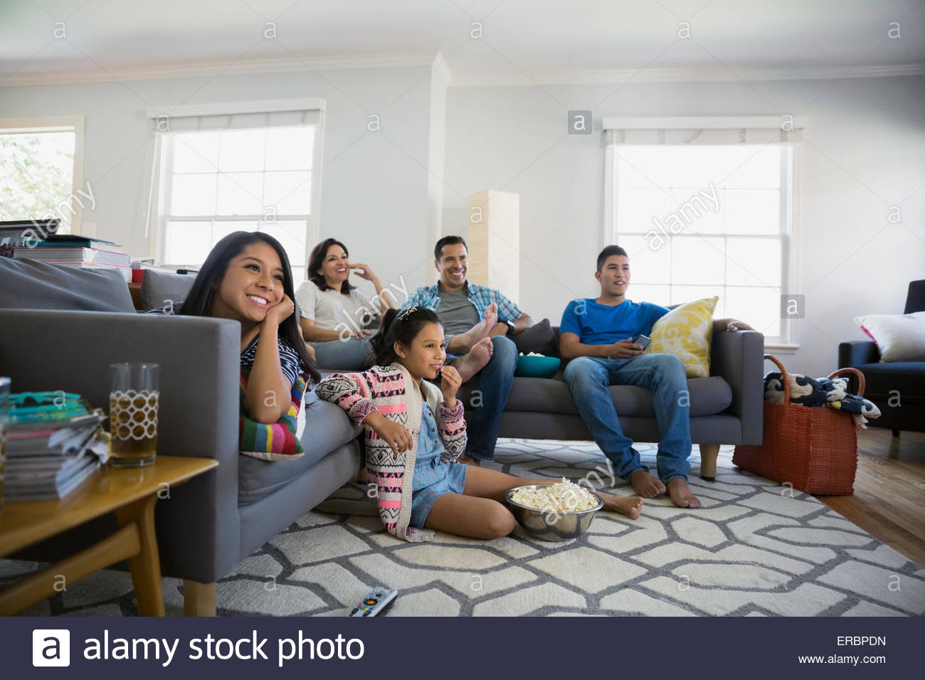 Tv In Living Room Family Watching Tv With Popcorn In Living Room Stock Photo