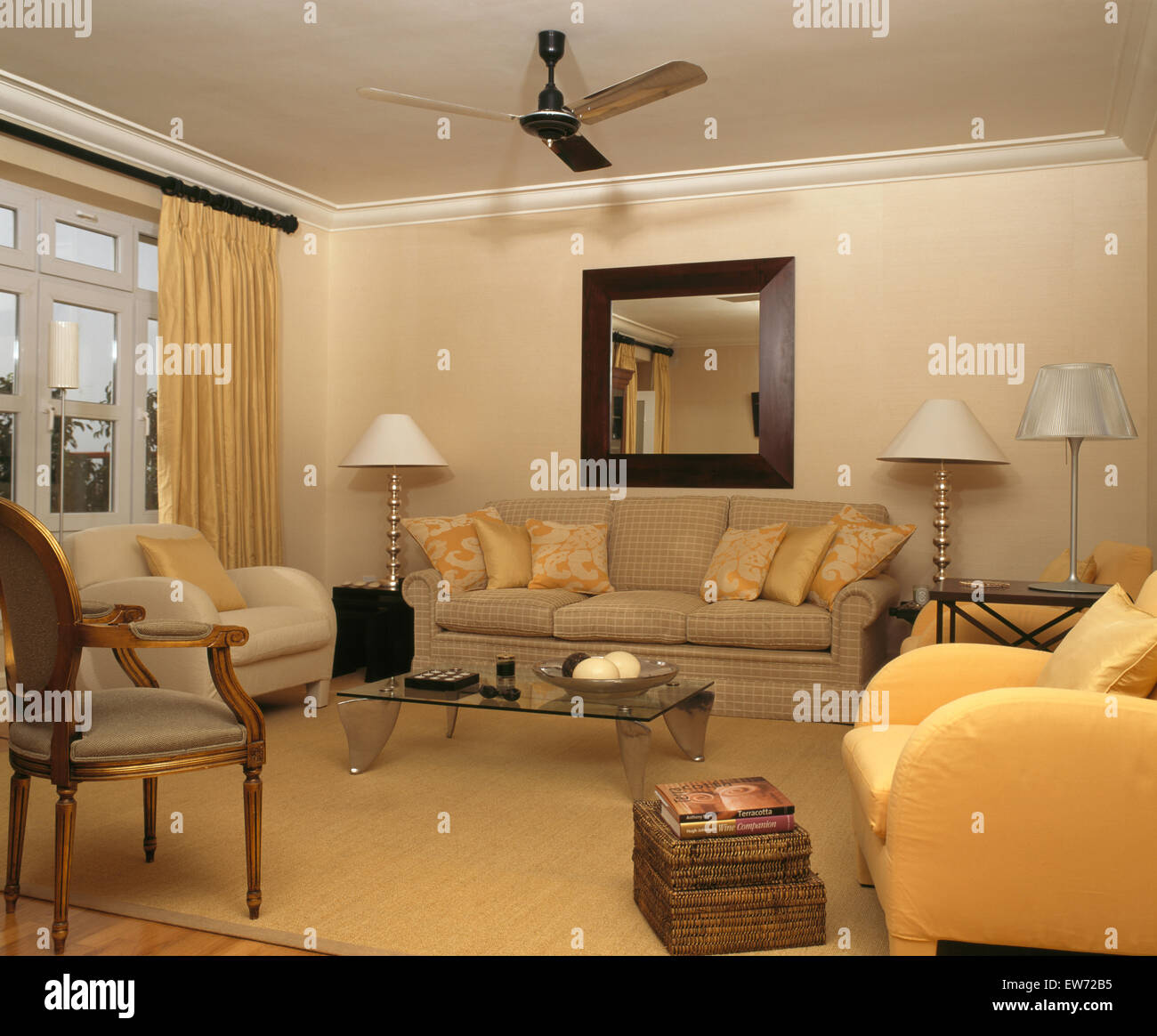 What Is Sofa In Spanish Yellow And Cream Armchairs And Sofa In Spanish Apartment Living