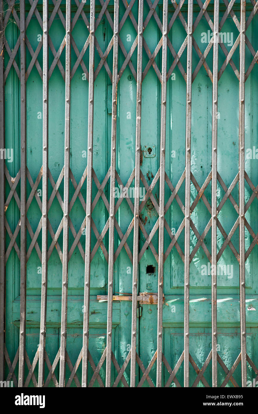 Store Metal Folding Old Metal Door Gate Of Abandoned Store Stock Photo