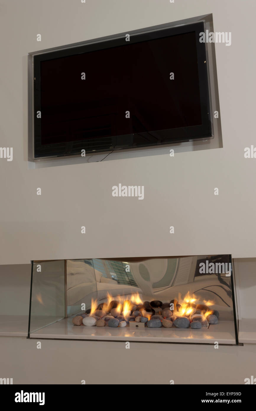 Modern Glass Fireplace Screens Modern Glass Fireplace Installed Under A Flat Screen Tv Stock