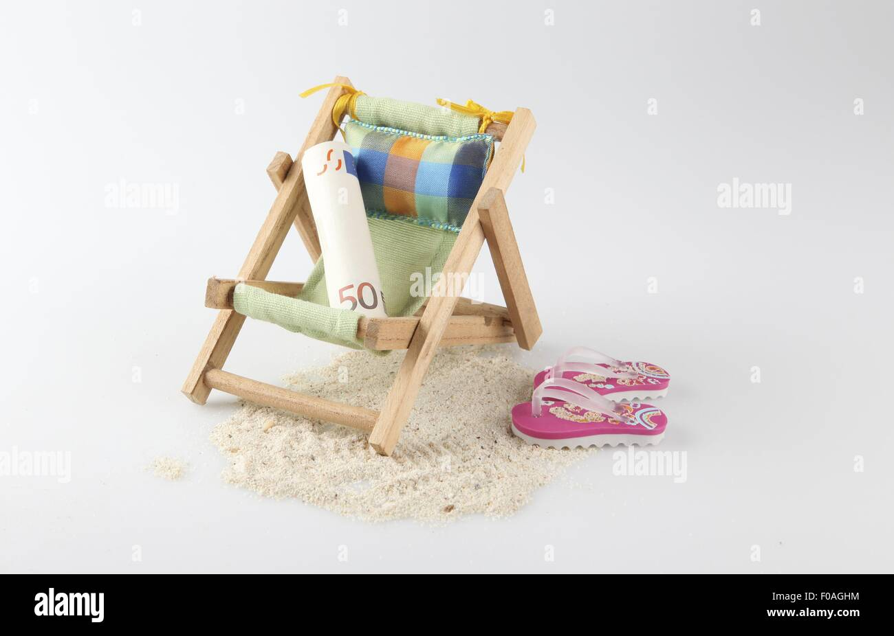 Flip Flop Chair Bed Rolled Up Currency On Small Deck Chair With Flip Flops And Sand