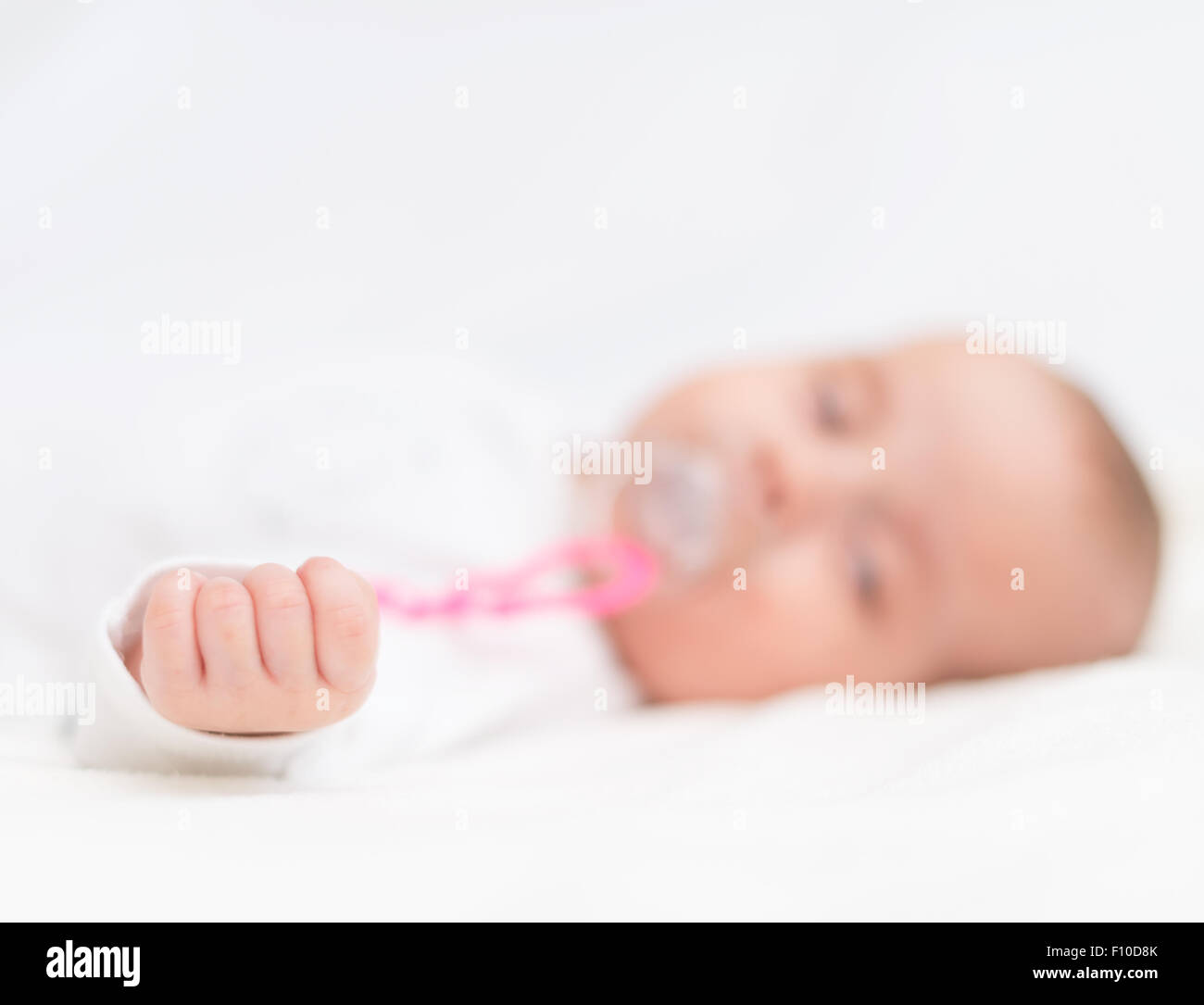 Newborn Babies For Dummies Newborn Little Baby With Dummy Sleeping On The Bed Stock