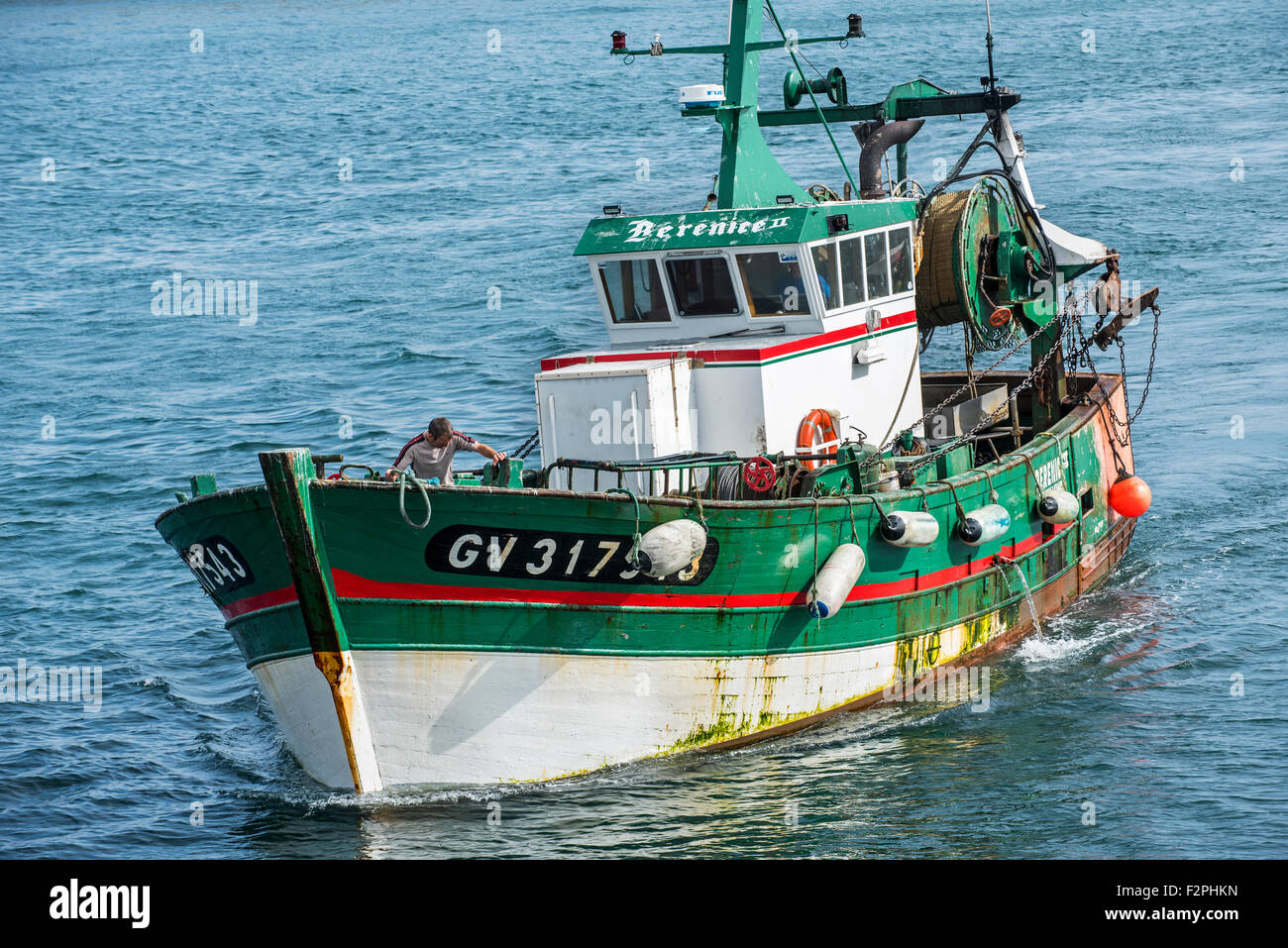 At Sea Fisherman On Board Of Green Wooden Trawler Fishing Boat At