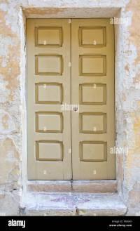 Beige door with square design pattern. Painted doors of ...