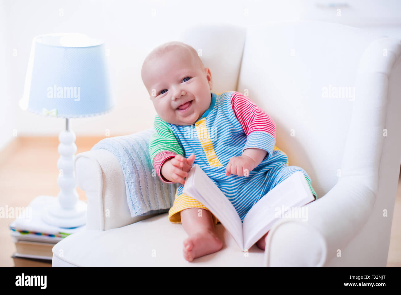 Cute Reading Chairs Cute Funny Baby Boy Reading A Book Sitting In A White