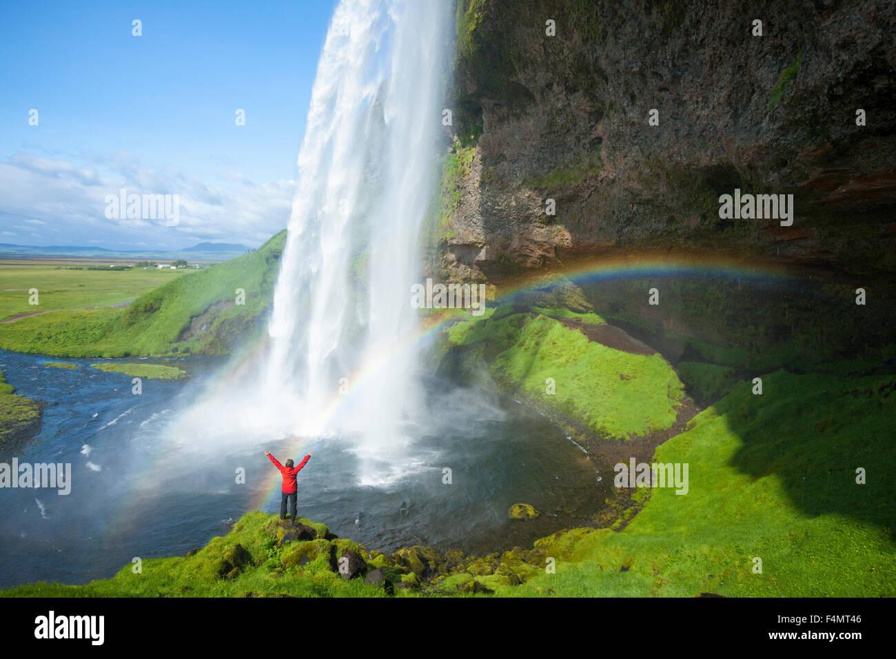 Live Falls Wallpaper Free Download Person And Rainbow Beneath 60m High Seljalandsfoss