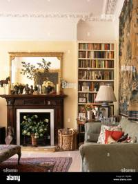 Gilt mirror above fireplace in a very traditional living ...