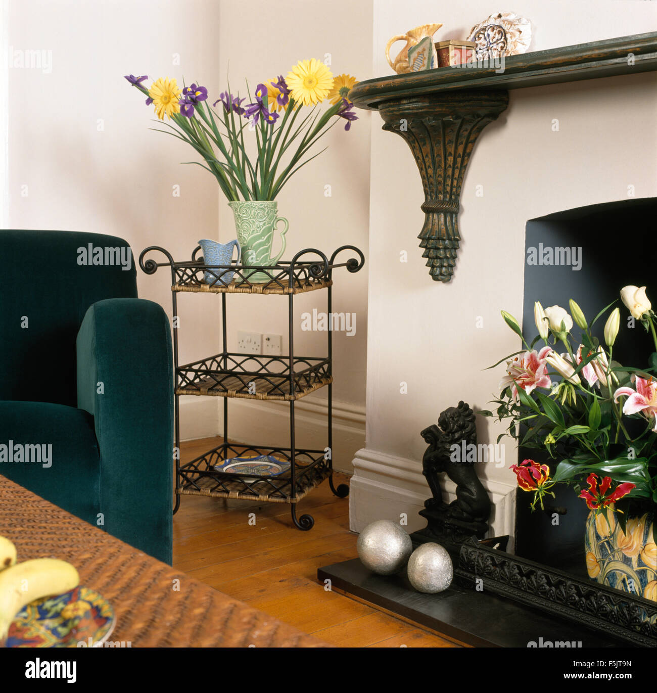Big Vases For Living Room Vase Of Flowers On A Wrought Iron Shelf Unit Beside