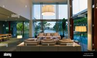 Lit double height living room in Cove Way House, Sentosa ...
