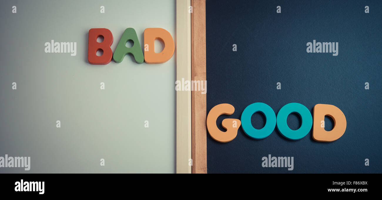 Bad Vintage Style Wooden Word Bad And Good On Black Board And White Board In