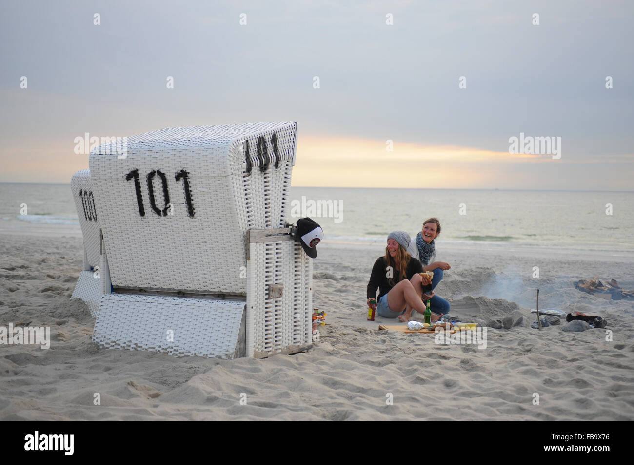 Sylt Strandkorb Strandkorb Beach Chair And Young People Having Picnic At Sunset On