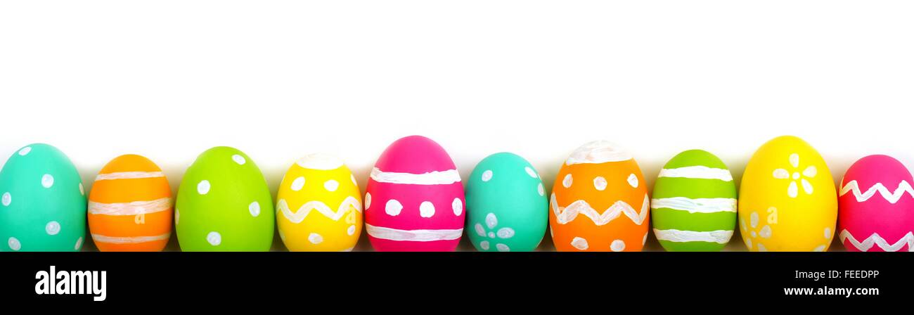 Colorful long Easter egg border against a white background Stock