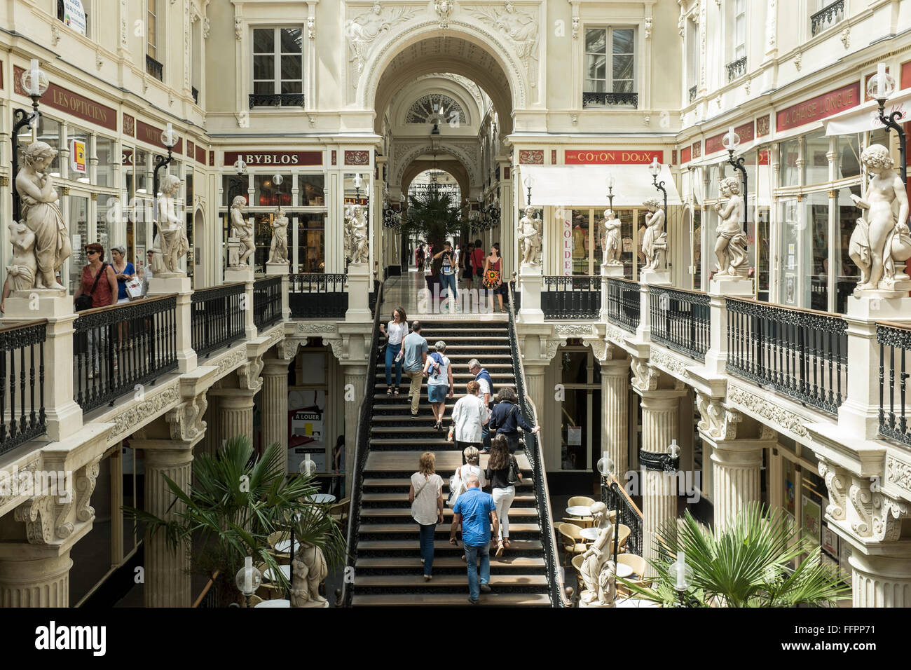 Coton Doux Nantes People Walk Through The Passage Pommeraye Shopping Centre In