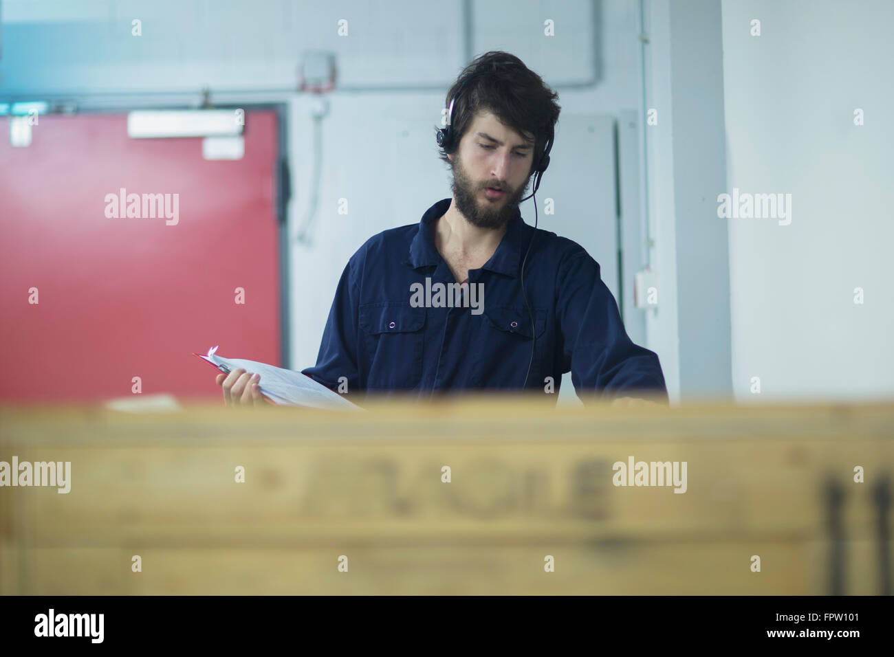 Container Freiburg Young Engineer Wearing Headset And Checking Cargo Container In An