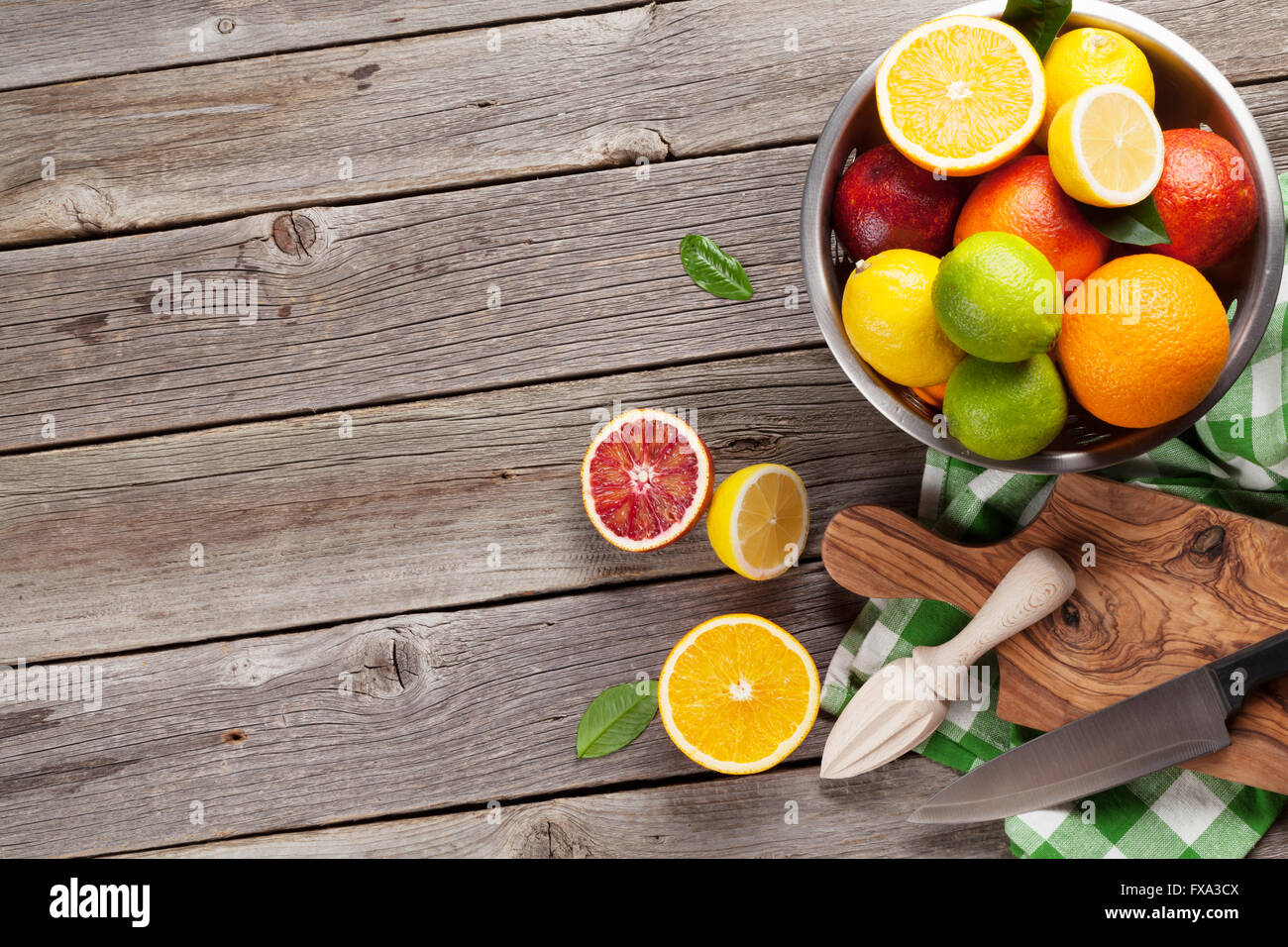 Table Top Fruit Basket Fresh Citrus Fruits In Colander On Wooden Table Top View