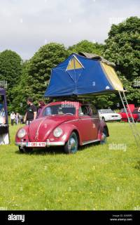 VW Volkswagen beetle car with a tent and ladder on its ...