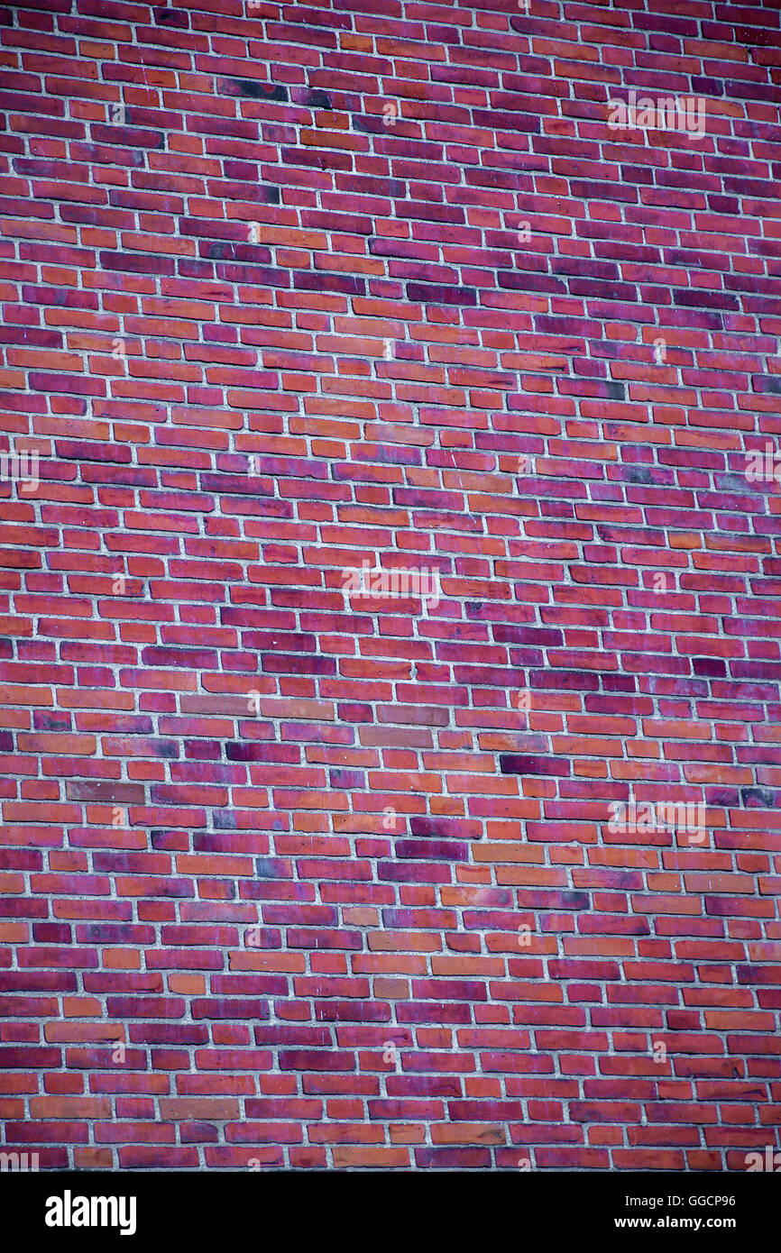 In Rosa High Brick Wall As A Background In Rosa Tones Stock Photo