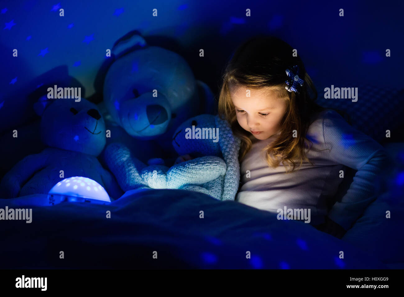 Girl Night Lights Little Girl Reading A Book In Bed Dark Bedroom With Night Light