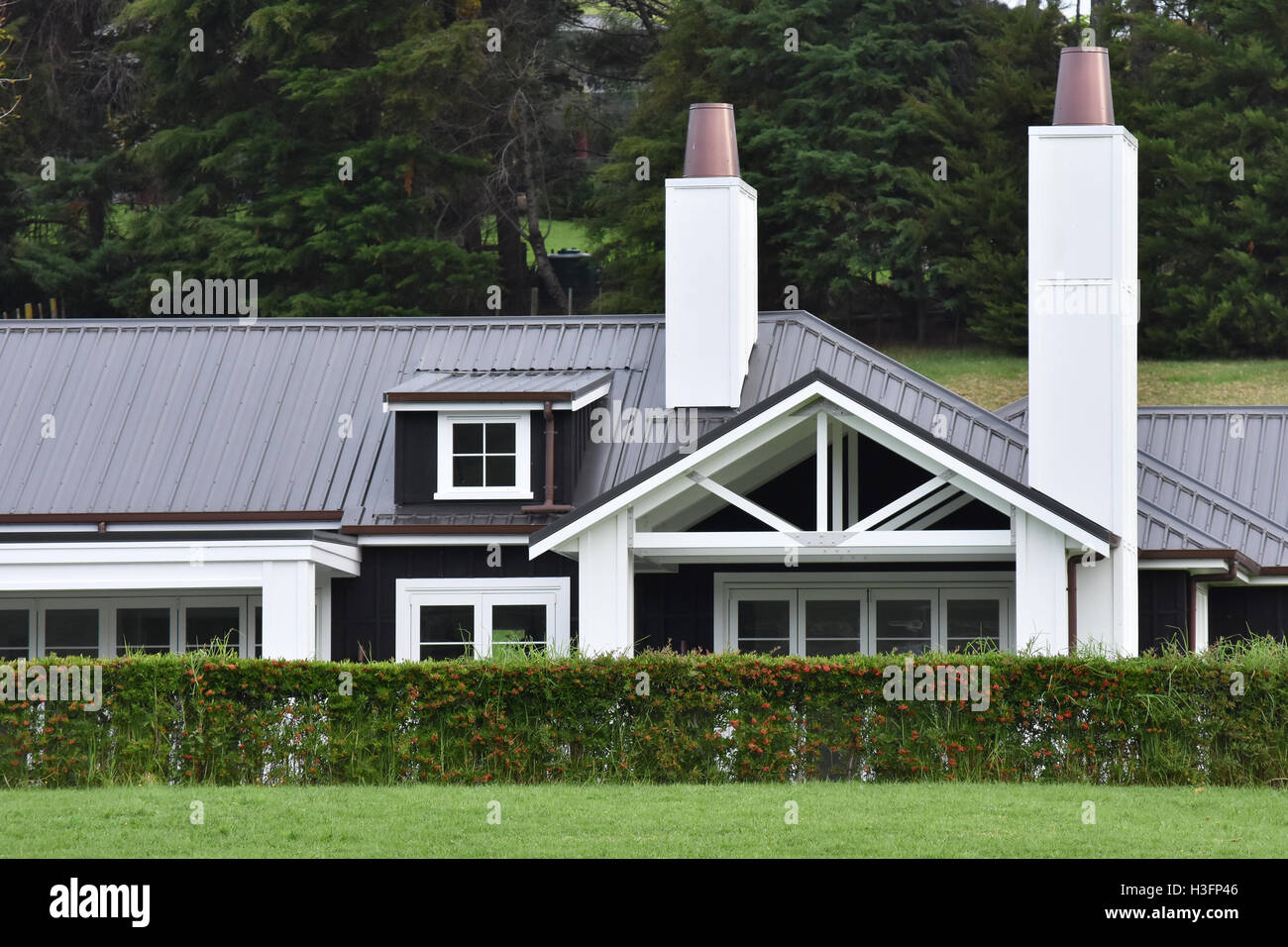 Countryside House With Metal Roof And Multiple Chimneys Stock Photo Alamy