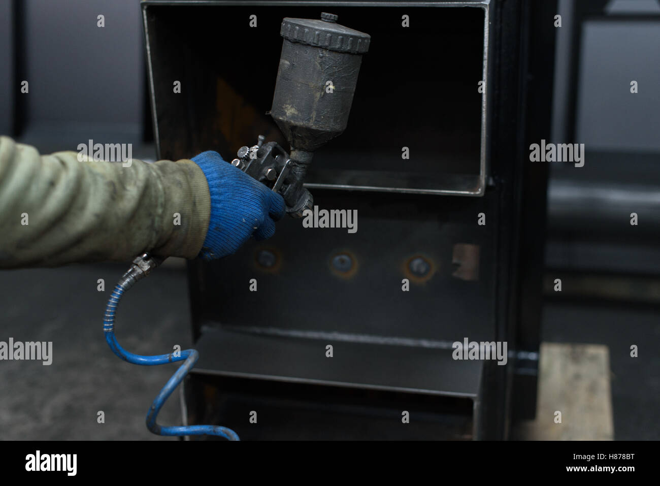 Closein Boiler Close Up Of Man S Hand Painting Black Solid Fuel Boiler Stock