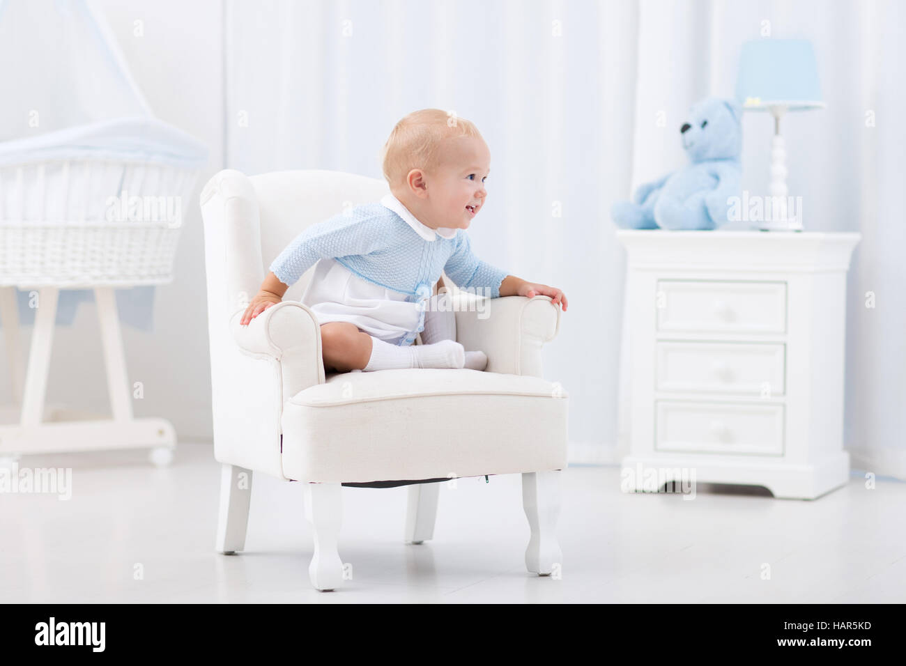 Infant Learning Chair First Steps Of Baby Boy Learning To Walk In White Sunny