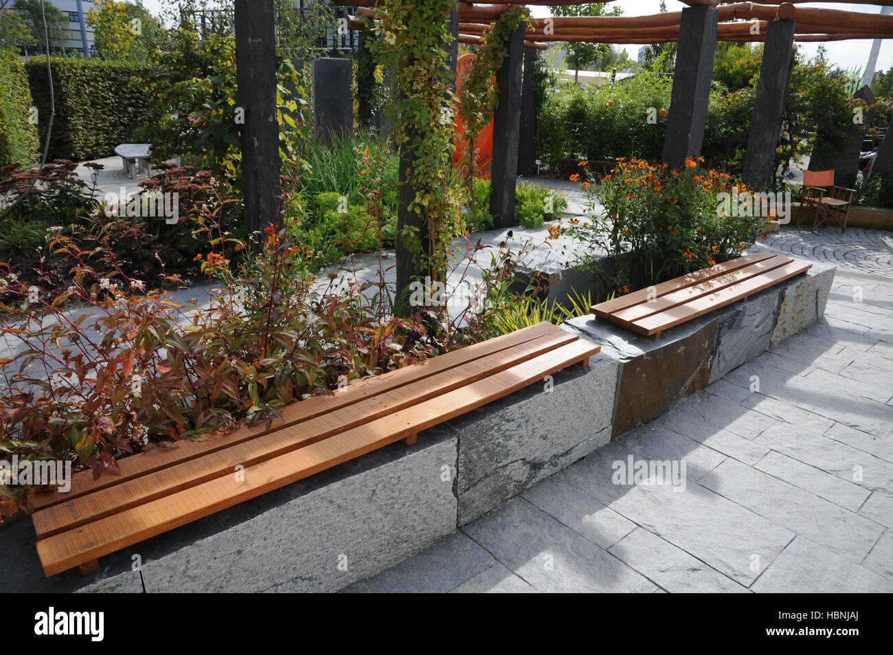Sitzbank Granit Garden With Bench Made Of Stone And Wood Stock Photo 127709194