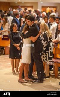 Formally dressed teens embrace after Confirmation mass at ...