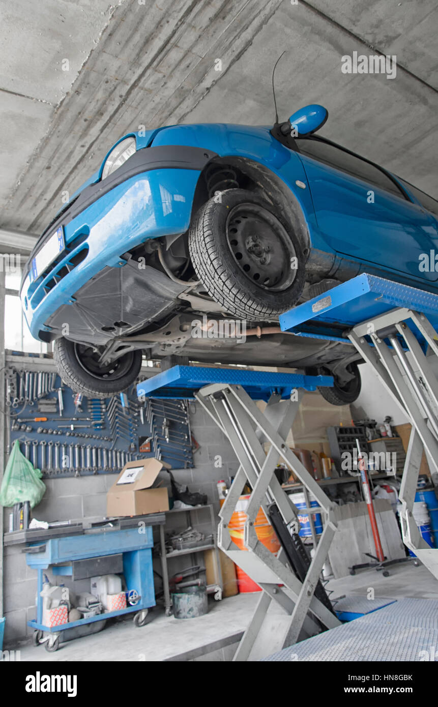Car Lift In Garage Auto Raised By The Car Lift In A Garage Stock Photo 133568839 Alamy