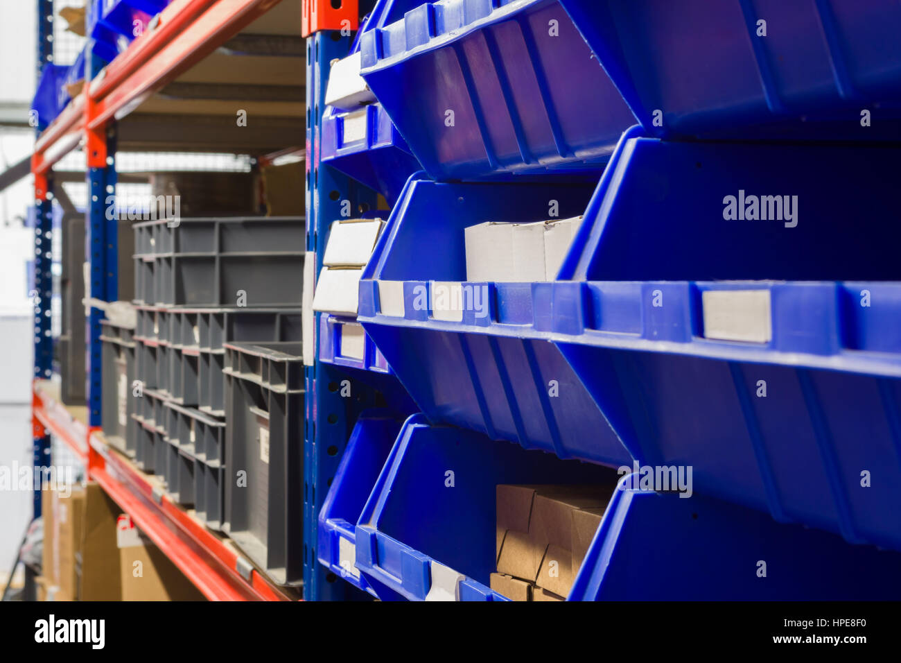 Storage Racks Storage Bins And Industrial Storage Racks In A Warehouse Shot With