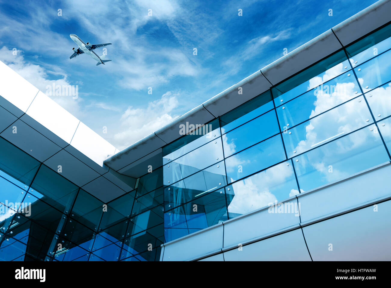 Glass Curtain Wall Manufacturer Glass Curtain Wall And Aircraft Against A Blue Sky Stock Photo