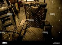 Old medieval torture chamber with a chair and tools Stock ...