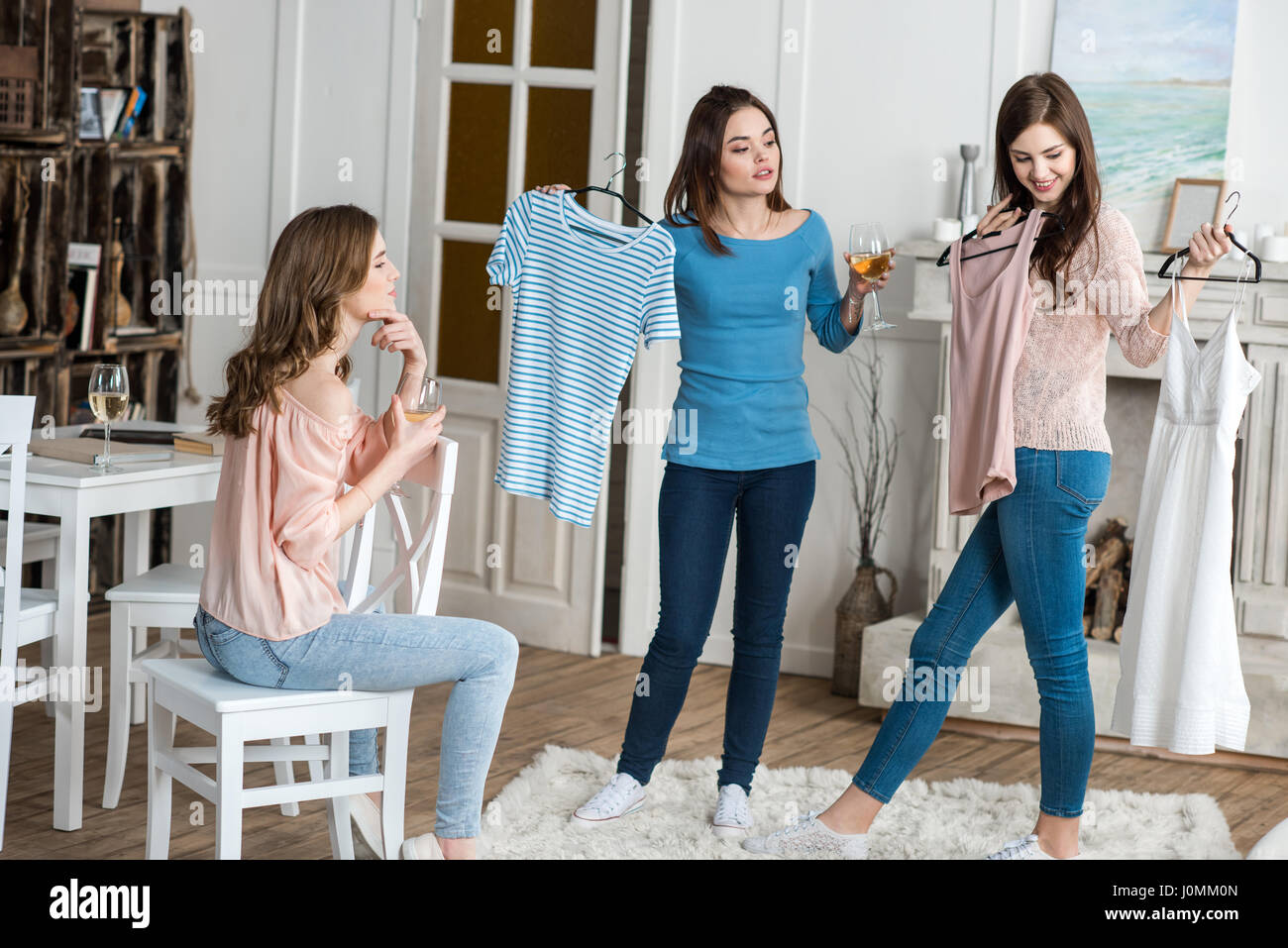 Stylish Clothes Three Young Attractive Women Choosing Stylish Clothes And Drinking